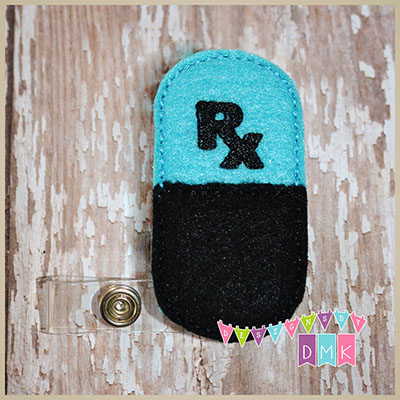 Rx Pill Capsule Brite Blue & Black Felt Badge Reel